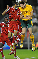 MELBOURNE, AUSTRALIA - OCTOBER 14: Joshua Kennedy from Australia heads the ball with Amad Al Hosni from Oman in a AFC Asian Cup 2011 match between Australia and Oman at Etihad Stadium on October 14, 2009 in Melbourne, Australia. Photo Sydney Low www.syd-low.com