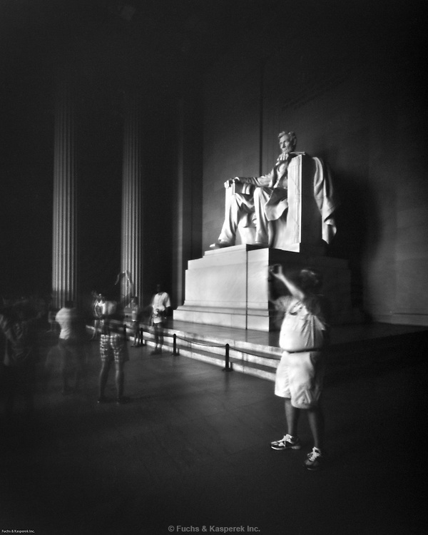 Tourists take pictures at the Lincoln Memorial in Washington, D.C.