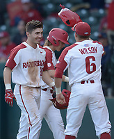 NWA Democrat-Gazette/ANDY SHUPE<br />Arkansas second baseman Carson Shaddy (left) is given the Hog hat by Hunter Wilson after hitting a solo home run against Kent State Friday, March 9, 2018, during the fifth inning at Baum Stadium in Fayetteville. Visit nwadg.com/photos to see more photographs from the game.