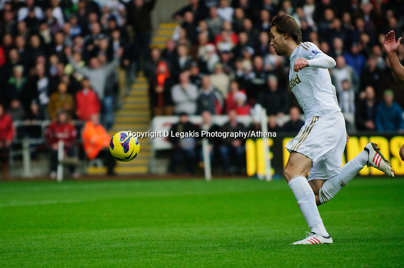 Sunday, 23 November 2012<br /> <br /> Pictured: Michu of Swansea City makes a run with the ball<br /> <br /> Re: Barclays Premier League, Swansea City FC v Manchester United at the Liberty Stadium, south Wales.