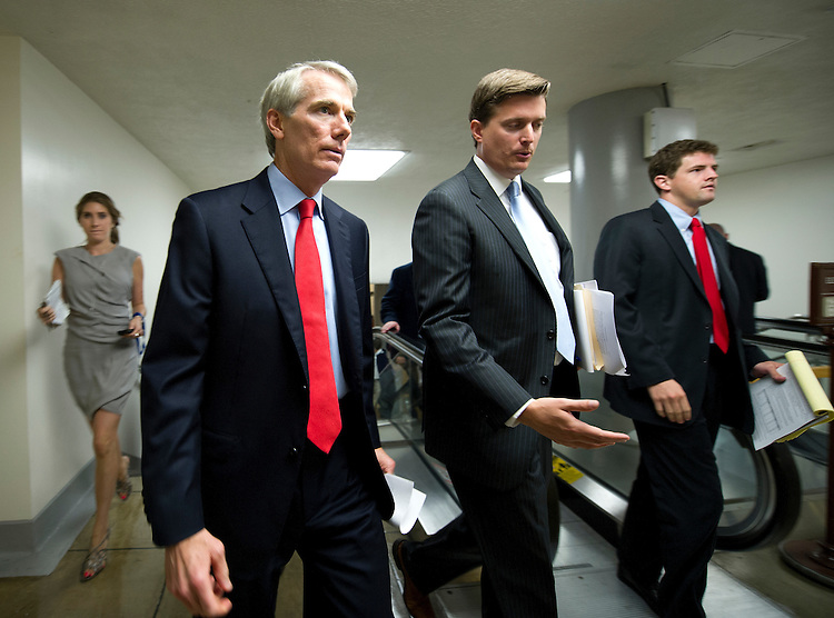 UNITED STATES - July 18: Sen. Rob Portman, R-OH., makes his way to the Senate policy luncheons through the Senate subway in the U.S. Capitol on July 18, 2013. (Photo By Douglas Graham/CQ Roll Call)