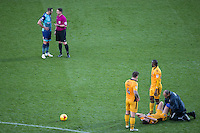 Referee Lee Collins has words with Paul Hayes of Wycombe Wanderers as Mark Randall of Newport County receives treatment during the Sky Bet League 2 match between Wycombe Wanderers and Newport County at Adams Park, High Wycombe, England on 2 January 2017. Photo by Andy Rowland.