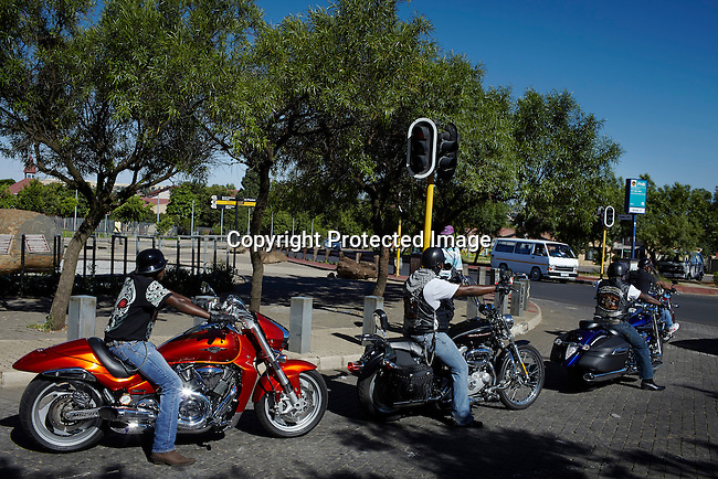 SOWETO, SOUTH AFRICA JANUARY 4: Black bikers ride their big bikes outside the historic Hector Pieterson Museum on January 4, 2013 in the Orlando section of Soweto, South Africa. Some newly wealthy Sowetans can afford to buy luxuries such as fancy houses, cars and bikes. Soweto today is a mix of old housing and newly constructed townhouses. A new hungry black middle-class is growing steadily. Many residents work in Johannesburg but the last years many shopping malls have been built, and people are starting to spend their money in Soweto. (Photo by: Per-Anders Pettersson)
