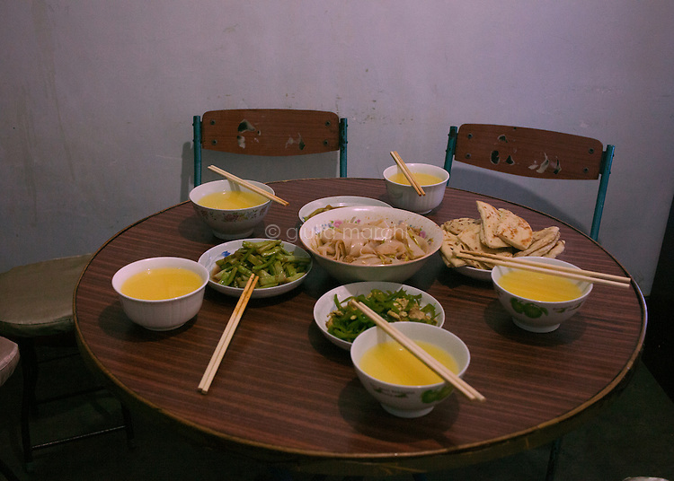 China / Shanxi Province / Baoji / 29.6.2013 / Dan Xianju, 75, Ding Lan's grandmother, has prepared the dinner for her family.  They eat Chinese, but always being respectful of the Islamic dietary law and buying food from halal shops.