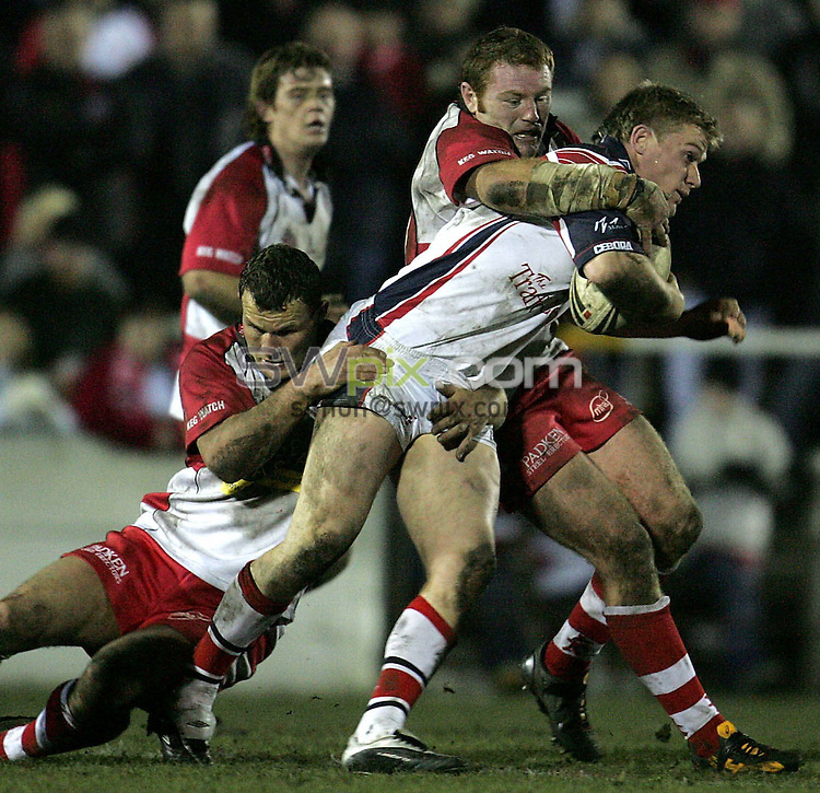 Pix: John Clifton/SWpix.com. Rugby League... Super League... Leigh Centurions v Salford... 26/02/2005..COPYRIGHT PICTURE>>SIMON WILKINSON>>07811 267 706>>..Anthony Stewart of Salford runs into two Leigh tacklers