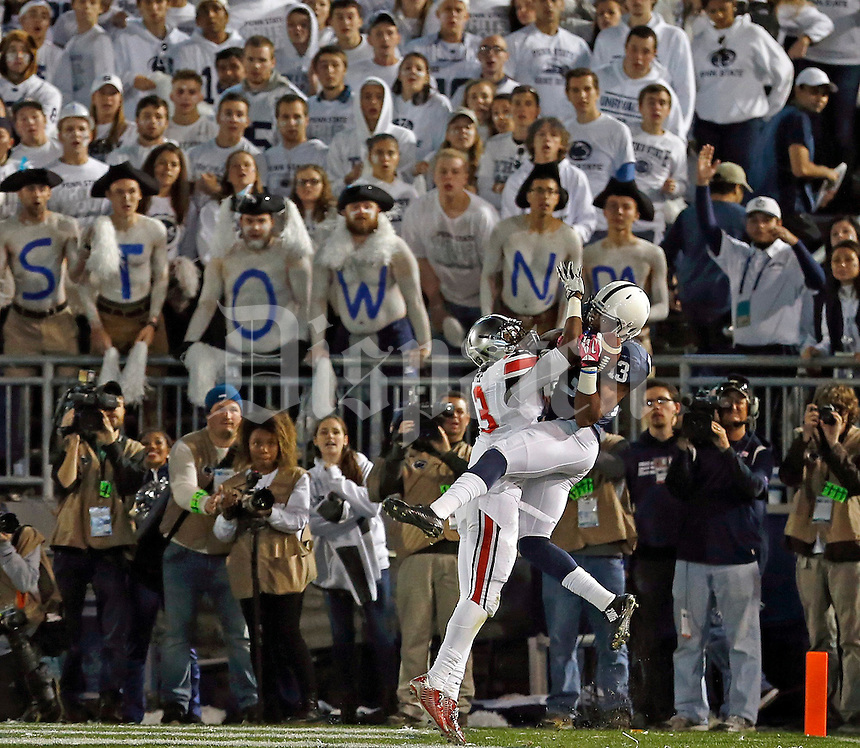Penn State Nittany Lions wide receiver Saeed Blacknall (13) grabs a touchdown pass against Ohio State Buckeyes cornerback Eli Apple (13) during the 4th quarter of the NCAA Division I football game at Beaver Stadium in University Park, PA on October 25, 2014. (Columbus Dispatch photo by Jonathan Quilter)