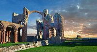 The Anglo Saxon Romanesque Lindisfarne Abbey ruins at sunset,  Holy Island, Lindisfarne, Northumbria, England