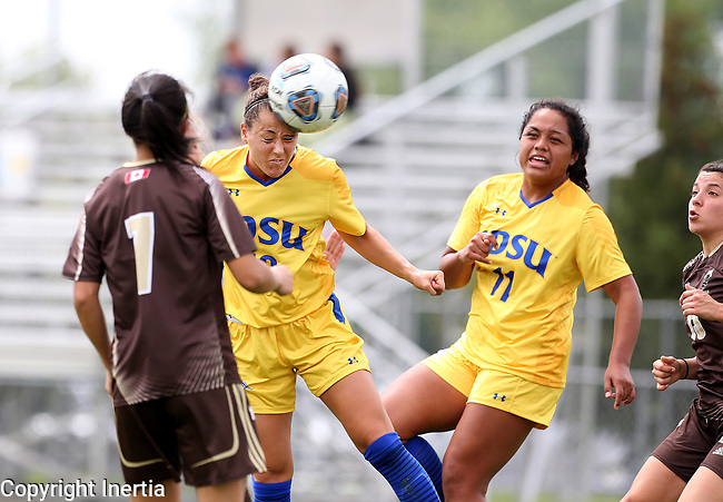 BROOKINGS, SD - AUGUST 13: Nicole Hatcher #10 from South Dakota State heads the ball past Hailey Lavarias #7 from Manitoba during the first half of their exhibition match Sunday afternoon at Fishback Soccer Park in Brookings. (Photo by Dave Eggen/Inertia)
