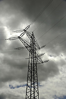 Electric pylon cloudy grey sky. Aschaffenberg, Germany.