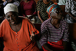 Port Au Prince, Haiti. Church goers shed a tear near St. Marc.