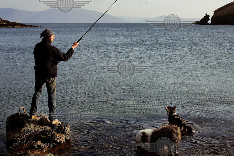 Nick Massett fishes in Dingle harbour on the west coast of Ireland.