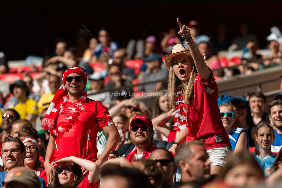 June 12, 2015: Swiss fans start a Mexican wave during a Group C match at the FIFA Women's World Cup Canada 2015 between Switzerland and Ecuador at BC Place Stadium on 12 June 2015 in Vancouver, Canada. Switzerland won 10-1. Sydney Low/AsteriskImages