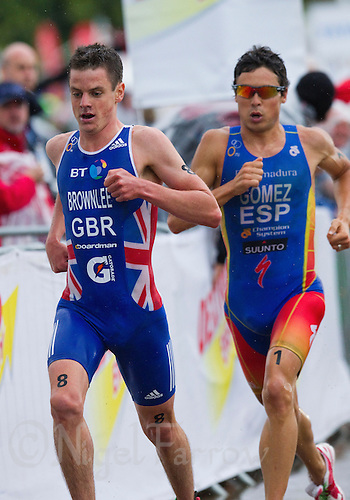 07 AUG 2011 - LONDON, GBR - Jonathan Brownlee (GBR) (left) leads Javier Gomez (ESP) (right) on the run during the men's round of triathlon's ITU World Championship Series .(PHOTO (C) NIGEL FARROW)