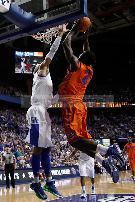 Florida's Patric Young goes for a dunk with UK's Willie Cauley-Stein in his face. in Lexington, Ky., on Sunday, March, 10, 2013. Photo by James Holt | Staff