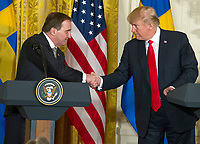 United States President Donald J. Trump and  Prime Minister Stefan Lofven of Sweden shake hands as they hold a joint press conference in the East Room of the White House in Washington, DC on Tuesday, March 6, 2018.<br /> CAP/MPI/RS<br /> &copy;RS/MPI/Capital Pictures
