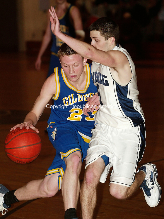 THOMASTON, CT- 03 MARCH 2005-030305J04-Gilbert's Tom Dileo (23) runs into Shepaug's Jim Lowe (5) as he drives to the basket during their Berkshire League semi-final game at Thomaston High School in Thursday.  --- Jim Shannon Photo--Gilbert, Shepaug, Jim Lowe, Tom Dileo, Thomaston High School are CQ