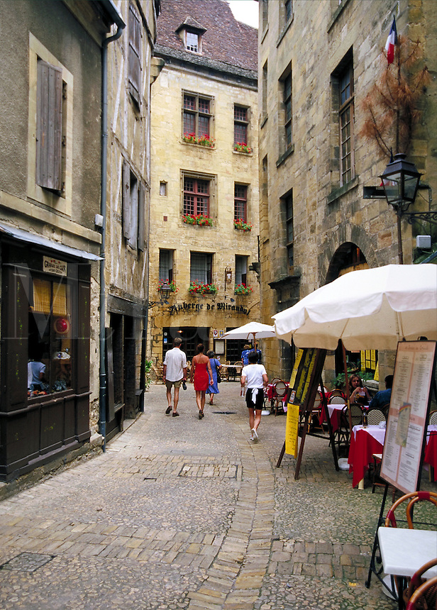 An alley cafe in Sarlat, France. street scene, cityscape, architecture. Sarlat France.