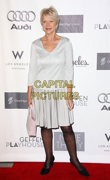 DAME HELEN MIRREN.Annual Backstage At The Geffen Gala held at the Geffen Playhouse, Los Angeles, California, USA..March 9th, 2009.full length black shoes silver grey gray skirt top pale pink bag purse .CAP/ADM/KB.©Kevan Brooks/AdMedia/Capital Pictures.