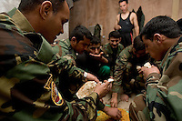 "Iraqi Minister of Interior Special Police Commandos from  2nd Company, 2nd Battalion, 2nd Brigade eat lunch in their room at camp Tiger,  Eastern Ramadi, Al Anbar Province, Iraq on Wednesday Feb 08 2006. Officers and enlisted men live in separate compounds. the officer's quality of life is extremely better than the enlisted men. At camp tiger the enlisted men have limited amounts of food. As on e of them said: "" This is all that we get for 10 men. I could eat this myself."" Civilian Iraqi contractors are in charge of feeding the unit but diversify the menus between officers and enlisted men.  The US military trainers tried to solve the problems but have no power to change the low standards at Camp Tiger."