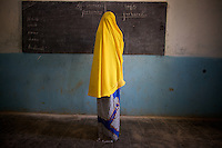 A child writes on the blackboard  during a lesson in her classroom in the compound of the Cluster resource Center of Lafaissa, Somali Region, Ethiopia on Monday November 9 2009. .The Lafaissa facility is supported by the British non governmental organization Save the Children UK..