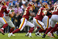 Landover, MD - December 9, 2018: Washington Redskins running back Adrian Peterson (26) runs the football during game between the New York Giants and Washington Redskins at FedEx Field in Landover, MD. The Giants defeated the Redskins 40-16 dropping the Redskins to 6-7 on the season. (Photo by Phillip Peters/Media Images International)