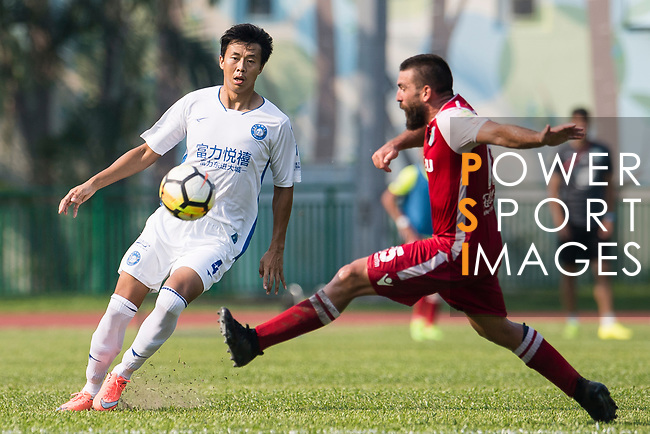 Zhao Ming of R&F F.C (L) fights for the ball with Marc Martinez of Kwoon Chung Southern (R) during the week three Premier League match between Kwoon Chung Southern and R&F at Aberdeen Sports Ground on September 16, 2017 in Hong Kong, China. Photo by Marcio Rodrigo Machado / Power Sport Images