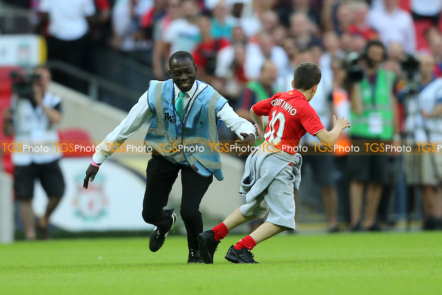 A young Liverpool fans makes his way onto the pitch and give a steward the run around during Liverpool vs FC Barcelona, International Champions Cup Football at Wembley Stadium on 6th August 2016