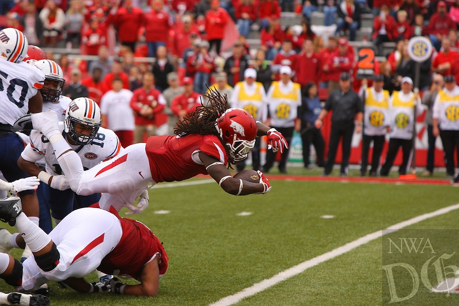 10/31/15<br /> Arkansas Democrat-Gazette/STEPHEN B. THORNTON<br /> Arkansas' Alex Collins dives in the end zone  for his fourth of his four running touchdowns against UT Martin's in the second quarter during their game Saturday in Fayetteville.