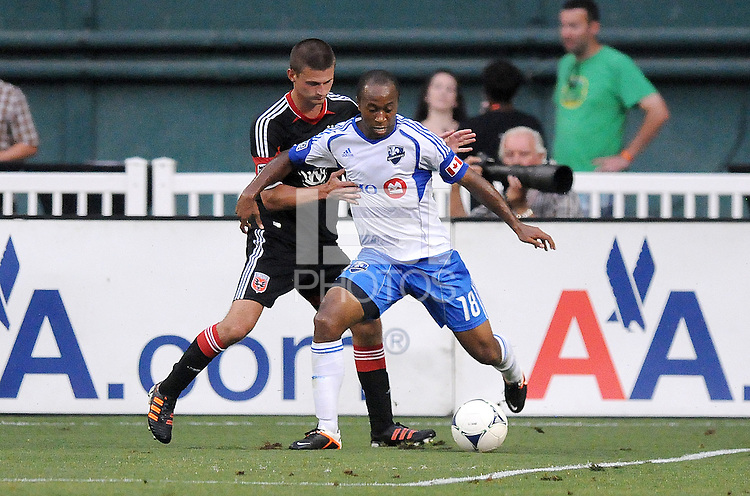 Montreal Impact midfielder Collen Warner (18) goes against D.C. United midfielder Perry Kitchen (23)  D.C. United defeated Montreal Impact 3-0 at RFK Stadium, Saturday June 30, 2012.
