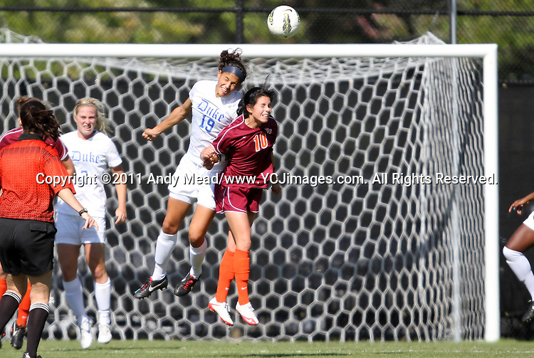 02 October 2011: Duke's Kim DeCesare (19) heads the ball over Virginia Tech's Victoria Parkinson (CAN) (10). The Duke University Blue Devils defeated the Virginia Tech Hokies 1-0 at Koskinen Stadium in Durham, North Carolina in an NCAA Division I Women's Soccer game.