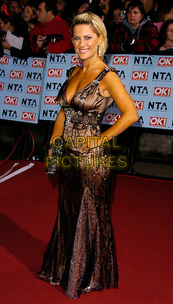 GEORGINA BOUZOVA.The National Television Awards 2006 held at the Royal Albert Hall, London, UK. - Arrivals.October 31st, 2006.Ref: CAN.full length dress hand on hip brown black.www.capitalpictures.com.sales@capitalpictures.com.©Can Nguyen/Capital Pictures