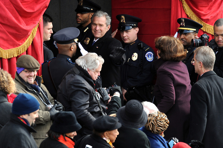 Former President George W. Bush leaves the west front of the Capitol after 56th Inaugural where Barack Obama was sworn in as the 44th president of the United States, January 20, 2009.