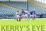 Jack Sherwood  East Kerry holds off Brian O Conaill and Tom Leo O'Sullivan Dingle during the County Championship game in Fitzgerald Stadium on Sunday