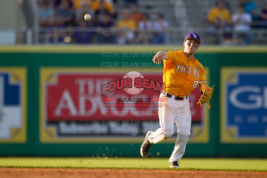 LSU Tigers shortstop Alex Bregman (8) makes an unbalanced throw to first base during the Southeastern Conference baseball game against the Texas A&M Aggies on April 25, 2015 at Alex Box Stadium in Baton Rouge, Louisiana. Texas A&M defeated LSU 6-2. (Andrew Woolley/Four Seam Images)