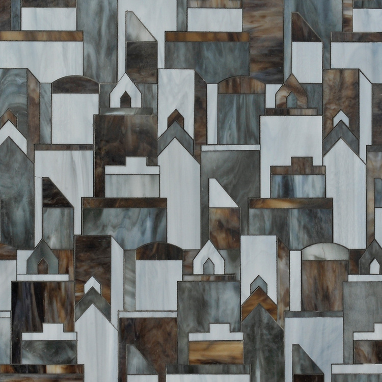 Cityscape, a glass waterjet mosaic shown in Lavastone, Pearl and Tourmaline, is part of the Erin Adams Collection for New Ravenna.