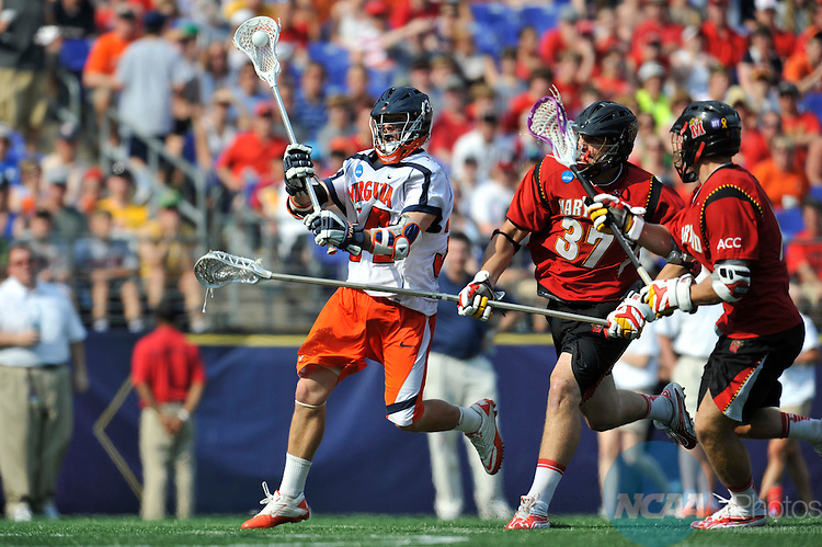 30 MAY 2011:  Colin Briggs (34) of the University of Virginia shoots on goal while Brian Farrell (37) of the University of Maryland defends during the Division I Men's Lacrosse Championship held at M+T Bank Stadium in Baltimore, MD.  Virginia defeated Maryland 9-7 for the national title. Larry French/NCAA Photos
