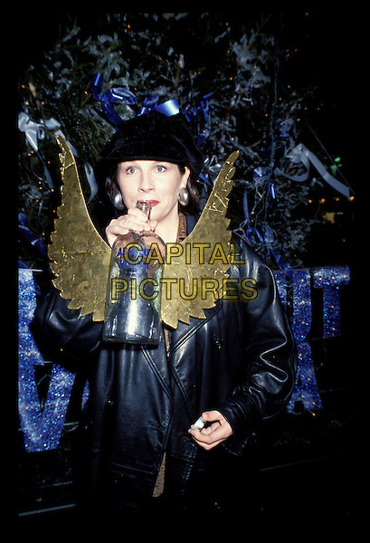 JENNIFER SAUNDERS.Jennifer Saunders Archive.Ref:Phil Loftus.half length drinking alcohol Absolut vodka gold wings.sales@capitalpictures.com.www.capitalpictures.com.©Capital Pictures.