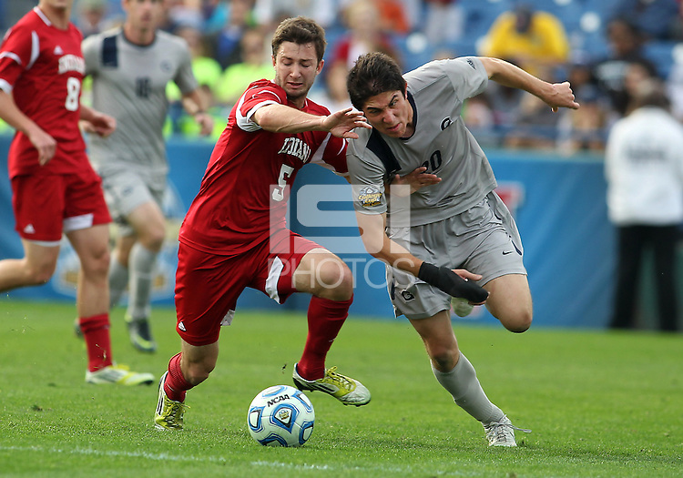 HOOVER, AL - DECEMBER 09, 2012: Matt McKain (5) of Indiana University stops Andy Riemer (20) of Georgetown University during the NCAA 2012 Men's College Cup championship, at Regions Park, in Hoover , AL, on Sunday, December 09, 2012.