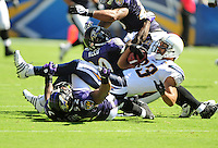 Sep. 20, 2009; San Diego, CA, USA; San Diego Chargers wide receiver (83) Vincent Jackson gets tackled by the Baltimore Ravens at Qualcomm Stadium in San Diego. Baltimore defeated San Diego 31-26. Mandatory Credit: Mark J. Rebilas-