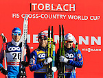 Alexander Bessmertnykh, Martin Johnsrud Sundby, Sjur Roethe at the podium the FIS Cross Country Ski World Cup15 Km Individual Classic race in Dobbiaco, Toblach a, on December 20, 2015. Norway's Martin Johnsrud Sundby wins. Credit: Pierre Teyssot