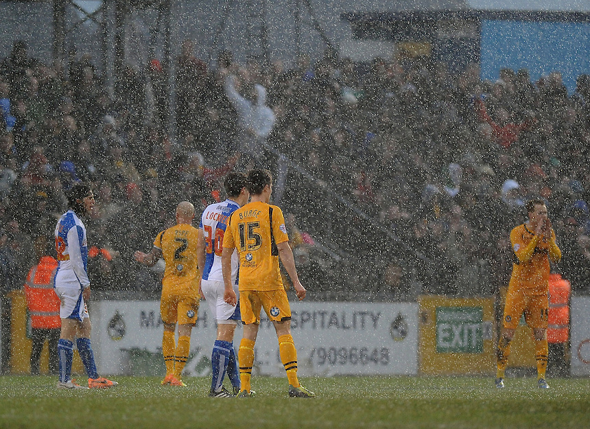 Players from Bristol Rovers and Newport County during a hail storm<br /> <br /> Photo by Ashley Crowden/CameraSport<br /> <br /> Football - The Football League Sky Bet League Two - Bristol Rovers v Newport County AFC - Saturday 25th January 2014 - Memorial Stadium - Bristol<br /> <br /> &copy; CameraSport - 43 Linden Ave. Countesthorpe. Leicester. England. LE8 5PG - Tel: +44 (0) 116 277 4147 - admin@camerasport.com - www.camerasport.com