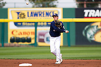 Cam Schiller (9) of the Oral Roberts Golden Eagles warms up by throwing to first during a game against the Missouri State Bears on March 27, 2011 at Hammons Field in Springfield, Missouri.  Photo By David Welker/Four Seam Images
