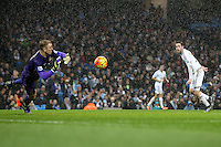 Gylfi Sigurdsson watches as Joe Hart reacts to his shot on goal during the Barclays Premier League Match between Manchester City and Swansea City played at the Etihad Stadium, Manchester on 12th December 2015