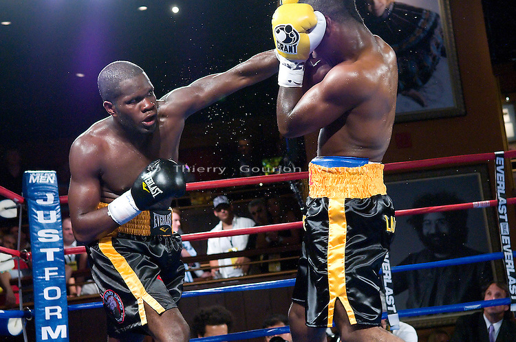 New York, NY - 06.11.2008: Sechew Powell on the attack against Deandre Latimore (yellow gloves) during their 10 rounds Jr. Middleweight fight at the Hard Rock Cafe in Times Square. Latimore upset Powell with a 7th round tko.