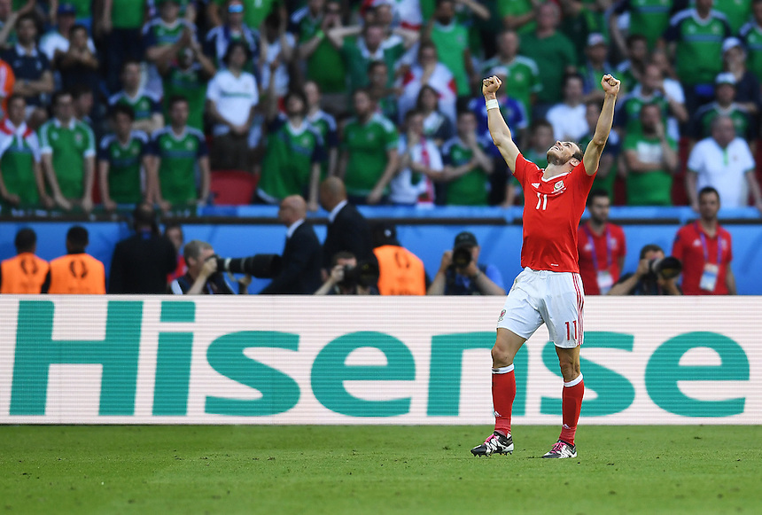 Wales's Gareth Bale celebrates his sides win<br /> <br /> Photographer Kevin Barnes/CameraSport<br /> <br /> International Football - 2016 UEFA European Championship - Round of 16 - Wales v Northern Ireland - Saturday 25th June 2016 - Parc des Princes - Paris - France<br /> <br /> World Copyright &copy; 2016 CameraSport. All rights reserved. 43 Linden Ave. Countesthorpe. Leicester. England. LE8 5PG - Tel: +44 (0) 116 277 4147 - admin@camerasport.com - www.camerasport.com