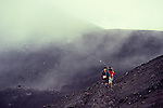 Adventure travel, people climbing active Pacaya volcano, Guatemala, central America,