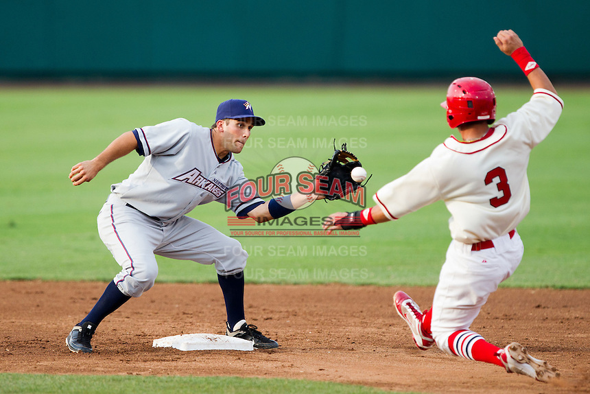 Jeff Bianchi (6) of the Northwest Arkansas Naturals attempts to turn a double play during a game against the Springfield Cardinals and the Springfield Cardinals at Hammons Field on July 30, 2011 in Springfield, Missouri. Springfield defeated Northwest Arkansas 11-5. (David Welker / Four Seam Images)