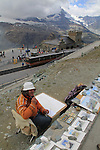Local artist with the Gornergrat train at the summit observatory in the Alps above Zermatt, Switzerland. .  John offers private photo tours in Denver, Boulder and throughout Colorado, USA.  Year-round. .  John offers private photo tours in Denver, Boulder and throughout Colorado. Year-round.