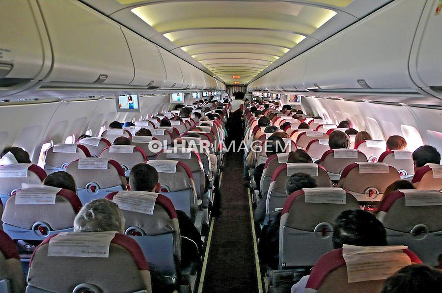 Passageiros em avião. Rio de Janeiro. 2007. Foto de Rogério Reis.