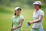 CHON BURI, THAILAND - FEBRUARY 16:  I.K. Kim of South Korea and Vicky Hurst of USA chat on the 15th hole during day one of the LPGA Thailand at Siam Country Club on February 16, 2012 in Chon Buri, Thailand. Photo by Victor Fraile / The Power of Sport Images